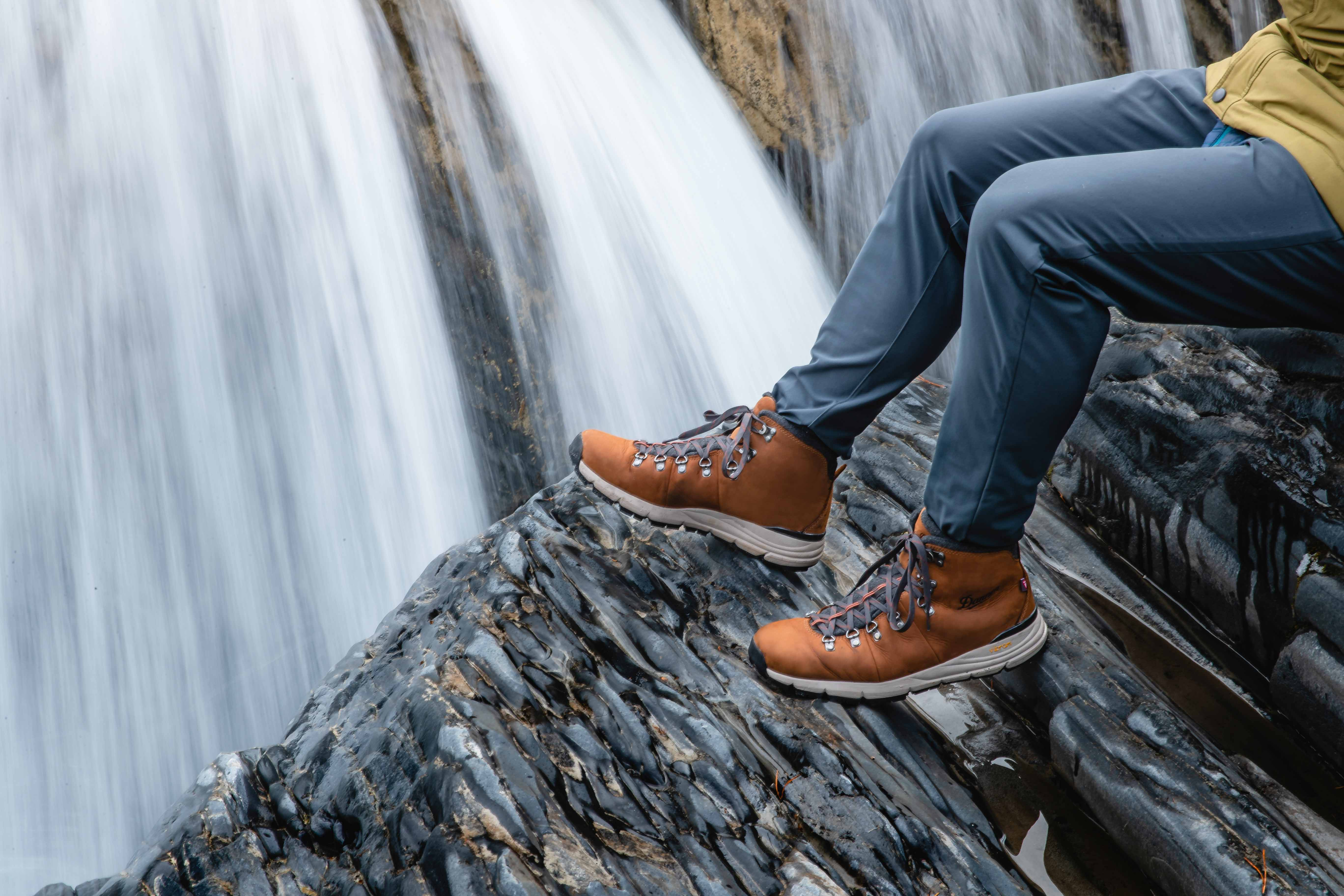 PhotographyCommercial Lifestyle photography of Danner Mountain 600 Boots in Canada by Andrew Studer of wearing leather danner boots Mountain 600 at a waterfall in Canada