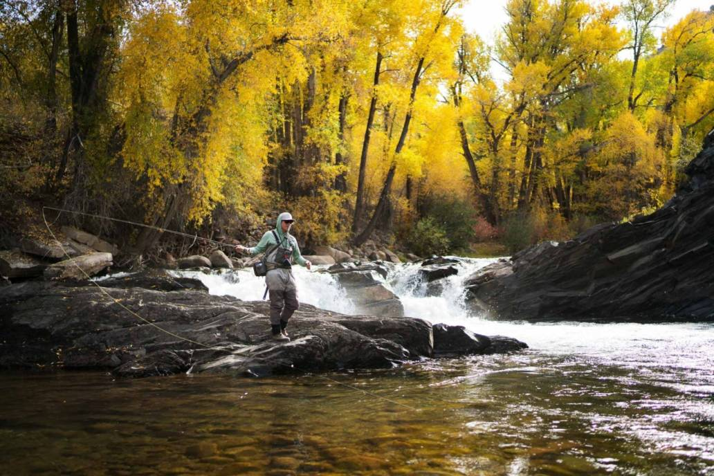 Commercial lifestyle photography of a fly fisherman in Aspen, Colorado