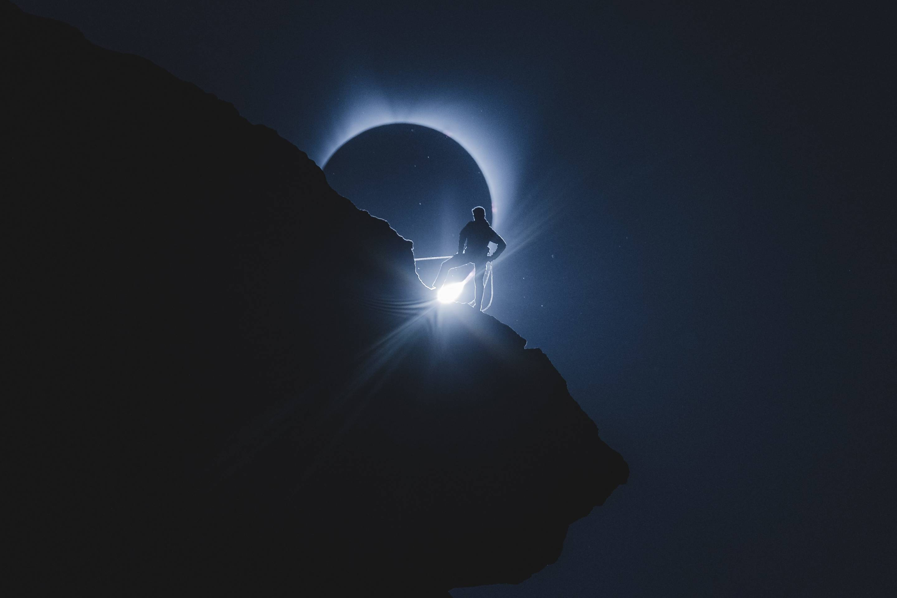 Viral photo of a climber in totality during the total solar eclipse of 2017. Photo taken at Smith Rock state park by Andrew Studer